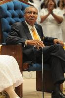 Rev Evans sits in his chair