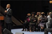 Shirley Caesar and Delois Washington listen as DeAndrae Patterson sings