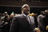 Pastor Marvin Winans sings along as CeCe Winans sings in the background